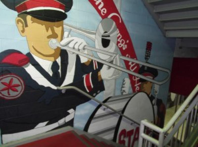 OSU Band Mural by artist Matt Adams appears in the stairwell leading to the Joan Zeig Steinbrenner Band Center.