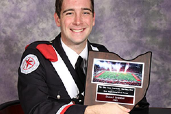 Daniel Brinker poses with his Most Inspirational Bandsperson award