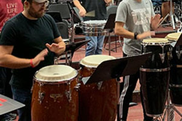 Latin Percussion players rehearse for Saturday's Santana halftime show