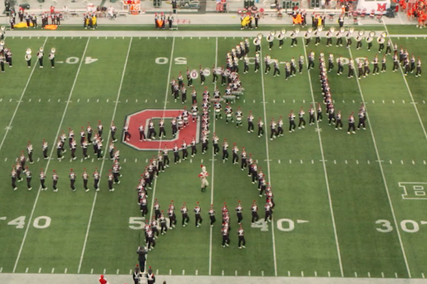 Marching band forms Mary Poppins on the field